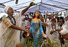 Devotees of Afro-Brazilian religions put offerings and pour cider over the sculpture of Yemanja, the African deity of the sea and fertility, to ask for a lucky 2010, during a ceremony at Copacabana beach, Rio de Janeiro,  Brazil, December 29, 2009.  (Austral Foto/Renzo Gostoli)