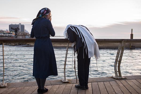 Praying at sunset - Tel Aviv Port