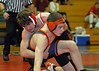 Cameron Neel chicken wings his opponent in a home wrestling match at SJS.