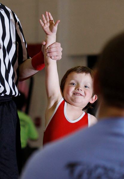 A young wrestler smiles big after winning a match at Princeton Community High School.
