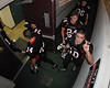 Four Varsity football players, including QB Lawson Gow, return to the locker room from a victory.