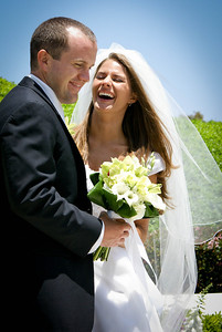 A genuine moment of laughter between bride and groom.
