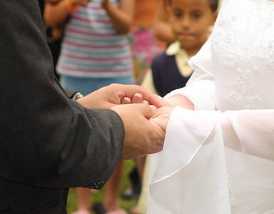 Most intimate of weddings involved hand holding during the part of the ceremony while loved ones simply and quietly gathered around the couple.
