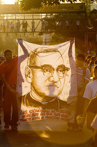 "Faithful in San Salvador commemorate the 27th anniversary of the martyrdom of Archbishop Óscar Arnulfo Romero y Galdámez.  The banner reads  ""The structures of social injustice are those which have given slow death to our poor.""  San Salvador, El Salvador, 2007"