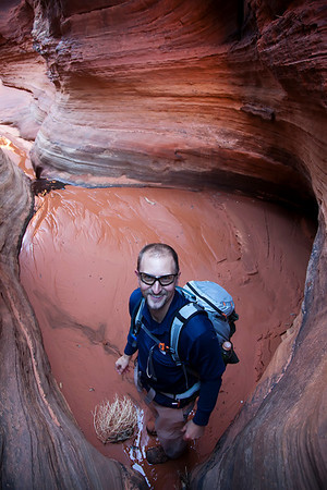 Jeff was guiding me through Buckskin Gulch. This picture was taken after me and my tripod saved him from the quicksand seen over his left shoulder.