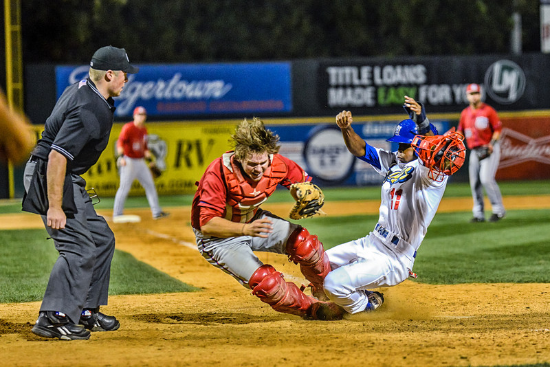 Quakes runner tagged out at home plate in game against 66ers.