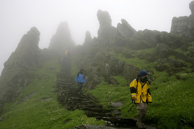 Hikers negotiating the path down from Skellig Michael (Great Skellig) near Portmagee, County Kerry, Ireland