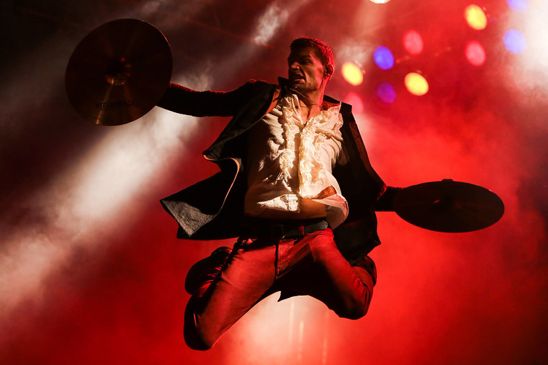 Luke Smallbone of For KING & COUNTRY leaps during a concert on August 16, 2014 in Papillion, Nebraska.