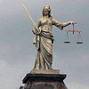 The statue of Justice atop a gate into Dublin Castle faces inwards into the castle and looks at her sword rather than the scales of justice.