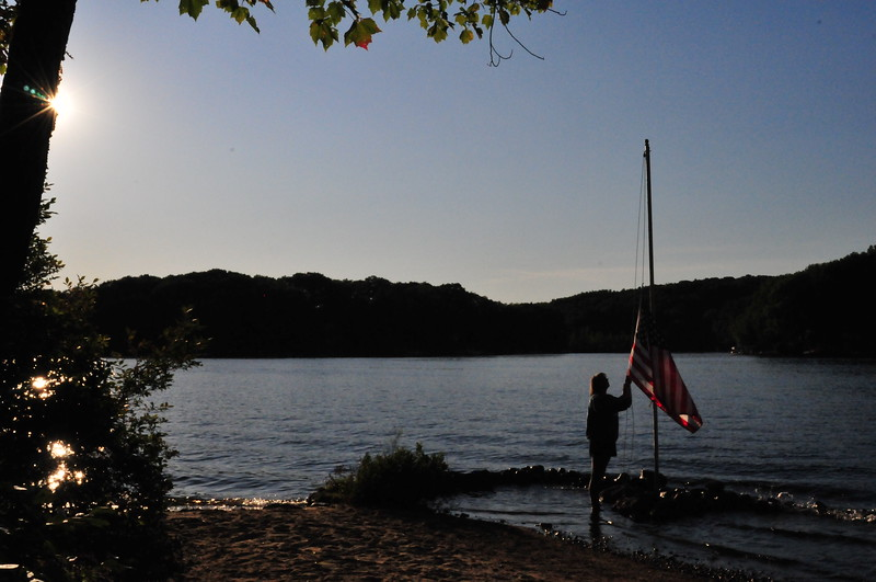 Labor Day at Lake Monomonoc, Rindge, New Hampshire, Marilyn takes down the flag