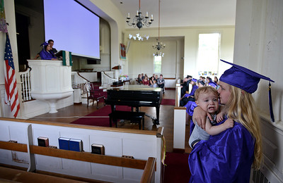 Northshore Recovery High School graduate Haley Conley, 17, tries to comfort her 11-month-old son Joel after he briefly got upset during the school's commencement ceremony at the Second Congregational Church of Beverly on Wednesday, June 1, 2016.