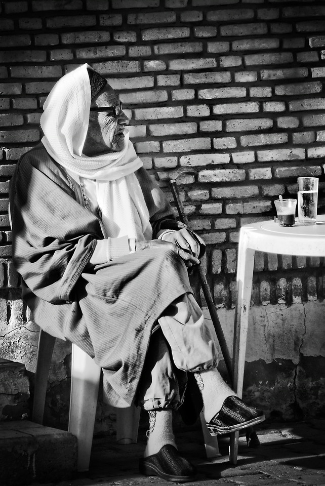 Old man in desert café