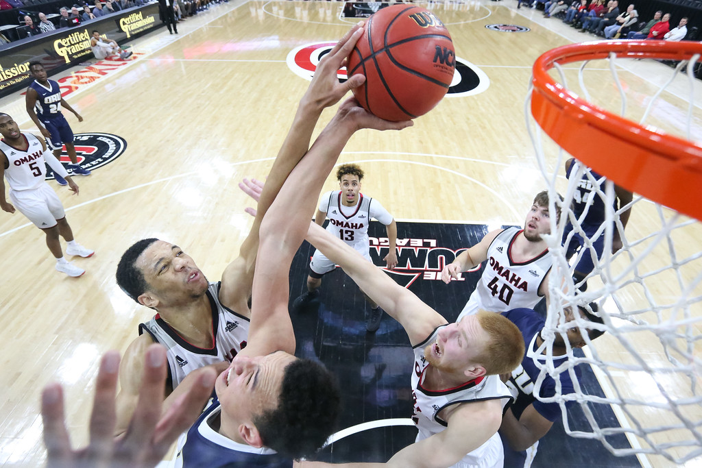 Omaha guard #21 Zach Jackson goes for a rebound against Oral Roberts University on February 22, 2018.
