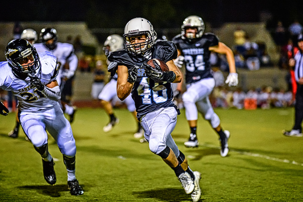 Joseph Powell of Villa Park runs for big gain against Canyon.