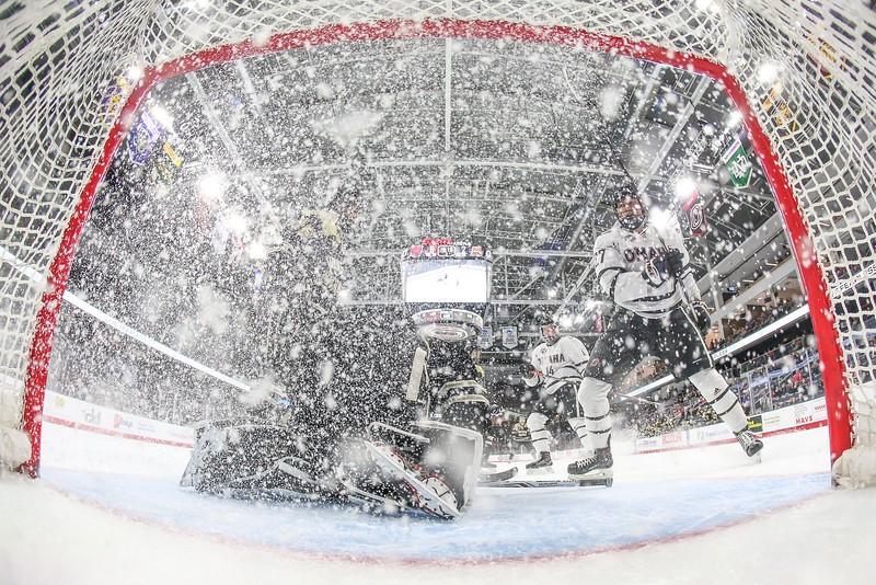 Omaha forward #27 Zach Jordan sprays ice on goal during an NCAA hockey game against Colorado College on February 23, 2018.