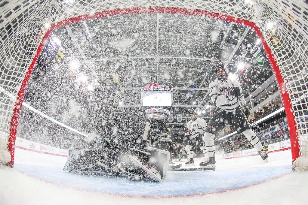 Omaha forward #27 Zach Jordan sprays ice on goal during an NCAA hockey game against Colorado College on February 23, 2018.