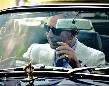 Guards Cartier 08 Prince Charles drives his convertible Vintage Aston Martin with no hands as it accelerates away form Guards Polo Club in England.