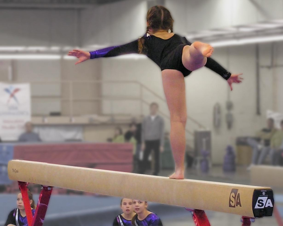 What I've always like about this photo is less about the gymnast on the beam and more about the two girls watching her from the floor.