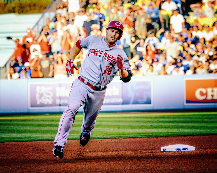 Chris Heisey of the Cincinnati Reds rounds second in game at Dodger stadium.