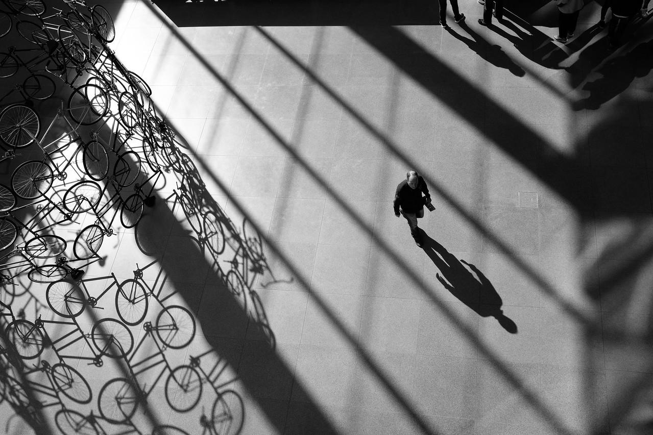 Lone Man, Bicycle sculpture, and Shadows at MFA