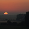 French Sunrise<br /> Sunrise in central France while driving back from riding La Marmotte in July 2011. Taken with a Canon 5D and a Sigma 70-200 mm f/2.8 lens. The exposure was 1/800 sec at f/5.6; ISO 400