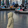 A young child ponders the bumper cars at Prater Park, Vienna, Austria.