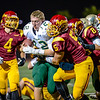 Brea Olinda quarterback continues to run through Esperanza defense as he loses his helmet.