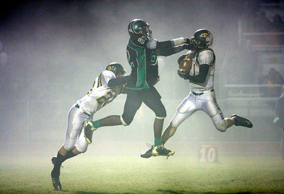 Auburn Journal Auburn, CA Sports Photo Michael Kirby Football Fog Photo Placer High Junior Josh Klem, right, intercepts a pass intended for Dixon's Daniel Williams as Placer's Kyle Hennen helps out in the foggy third quarter, Friday night in Dixon. The Hillmen had two interceptions and held Dixon to 237 yards of offense in the win.