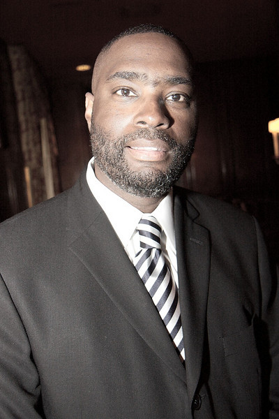 Antwone Fisher signs autograph. Dallas Children Advocacy Center Luncheon 2008. Jerry McClure Photographer