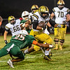 Jonah Mitchell breaks tackle as he runs for Bishop Moore in playoff game against Jones.