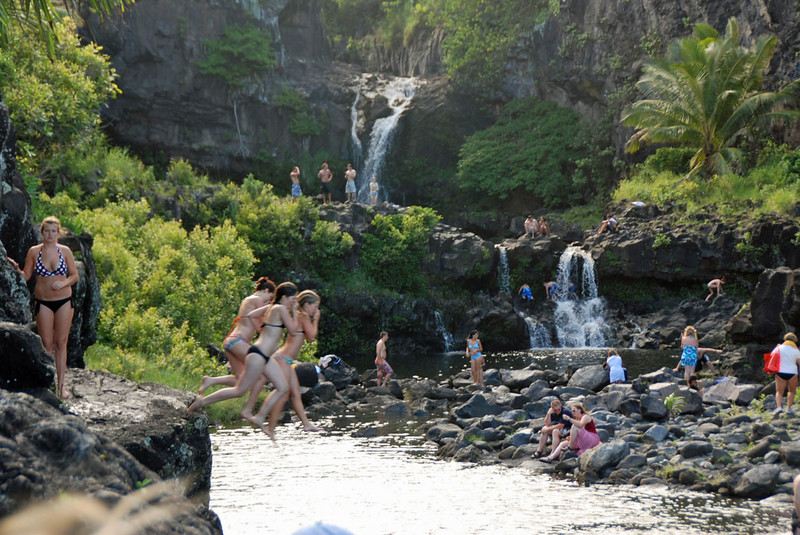 Girls diving into the pools below the waterfall.