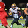 Malachi Rennie runs for big Bishop Moore gain against Tavares.