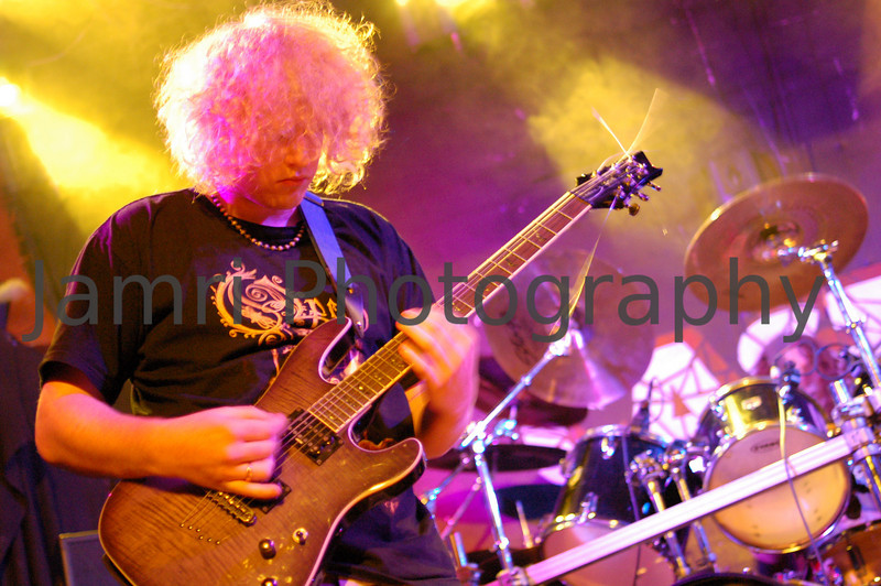"""Title: """"Shreddin""""<br /> Category: Live Music<br /> Venue: The Castle, Northbridge, Perth.<br /> Notes: Todd Kilgallon of Burial Grounds (aka Scourged Flesh) in during a guitar solo. Scourged Flesh / Burial Grounds are friends of mine in Australia and I've shot a number of their gigs. This photo was an available light shot using a Nikon D50 camera + a Nikkor 35mm f/2 lens (with 1.5x crop factor = 52mm). The key to capturing these kinds of shots is keeping watch of the changing stage lights for the right moment."""