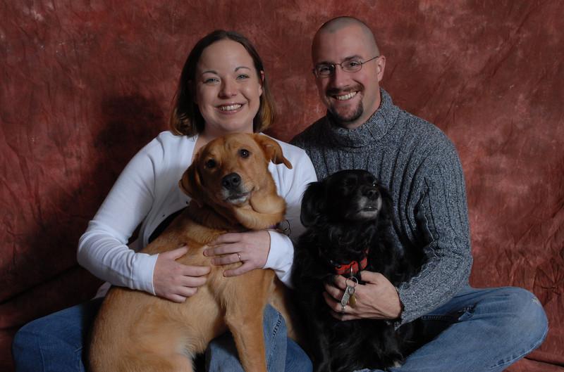 Mr. & Mrs. Devin Stewart and puppies