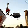 """Team Ro-Sham-Bo launches off the flight deck at Flugtag, a promotional event organized by Red Bull in which contestants build their own """"flying"""" machines and launch them off a platform into the water, in Austin, Texas on August 25, 2007."""