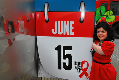 Minnie Mélange - Alternative Miss Ireland 2012 holding her giant sized calender pledge card to show that she will be out selling Red Ribbons for The Guide Clinic in St. Jame's Hospital for 'Irish Aids Day this Friday June 15th 2012' @IrishAidsDays