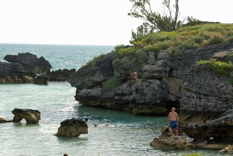 Boys jumping off the rocks into Tobacco Bay.