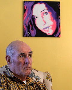 With a painting of his daughter Jackie on the wall behind him, John Zanfagna listens to his family talk about the heroin addiction that killed Jackie in the fall of 2014. Picture dated Oct. 25, 2015.