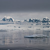 Midnight passage through the Neumayer Channel<br /> Low clouds shroud the mountains around the Neumayer Channel on the western side of the Antarctic Peninsula. Taken at midnight in December 2005 with a Canon 10D and a Sigma 28-70 mm f/2.8 lens; the exposure was 1/500 sec at f/8; ISO 400.