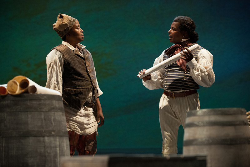 The Oregon Shakespeare Festival. 2013. The Liquid Plain by Naomi Wallace. Directed by Kwame Kwei-Armah. Scenic Design: Brenda Davis. Costume Design: Constanza Romero. Lighting Design: Christopher Ackerlind. Photo: Jenny Graham.