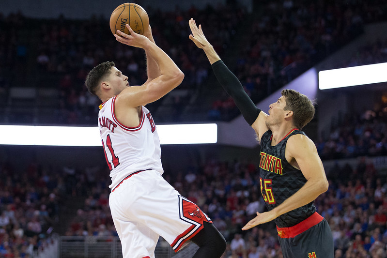 Chicago Bulls guard Doug Mcdermott (11) shoots over Atlanta Hawks guard Kyle Korver (26) during an NBA exhibition game on October 20, 2016 in Omaha, Nebraska.