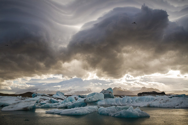 Incredibly dark and foreboding clouds dominate Jökulsárlón, the glacier lagoon on the borders of Vatnajökull National Park. High wind lenticular formations ripple through the skies above. It was truly a magical night in Iceland.