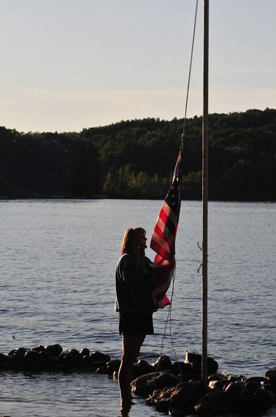 Labor Day at Lake Monomonoc, Rindge, New Hampshire, Marilyn takes down the flag