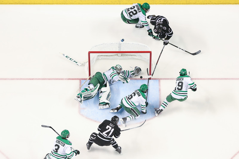 Omaha forward #17 Luke Nogard attempts a shot on goal against North Dakota on March 11, 2018.