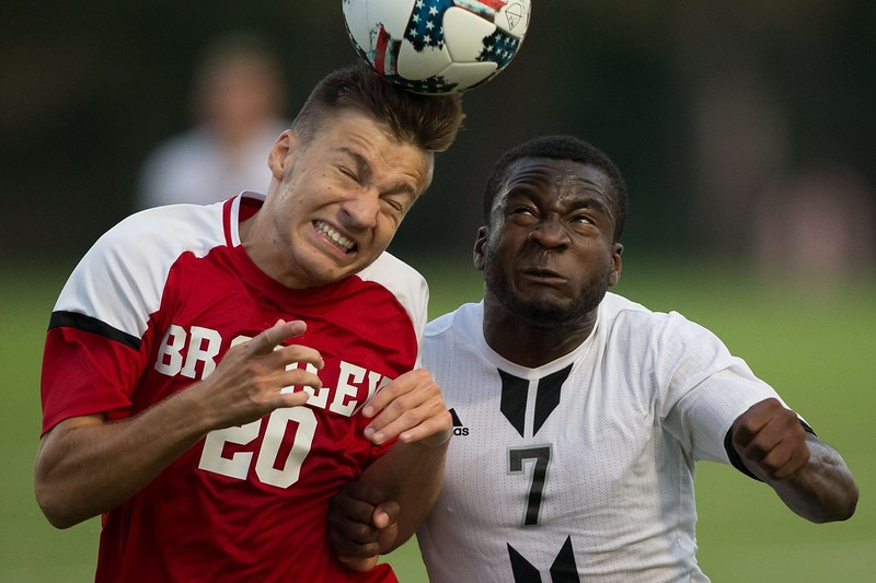 University of Nebraska-Omaha forward Emmanuel Hamzat goes for a header against Bradley on September 11, 2017 at Caniglia Field in Omaha, Nebraska.