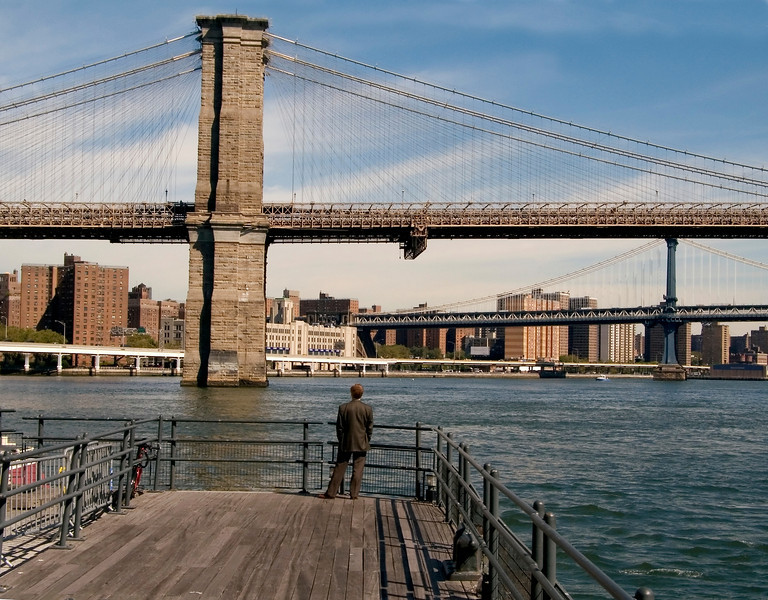 A scenic look at the Brooklyn Bridge over the East River in Manhattan.