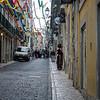 Woman in Doorway of Festive Street, Lisbon - Kent Atwell