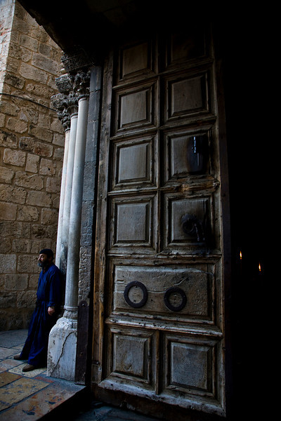 Doors and doorman at the Church of the Holy Sepulcher, Jerusalem