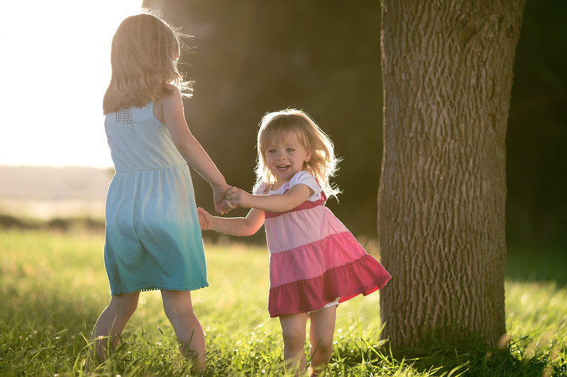 Harper Haas and younger sister Willa Haas dance in a barnyard at sunset on October 16, 2016 in Council Bluffs, Iowa.