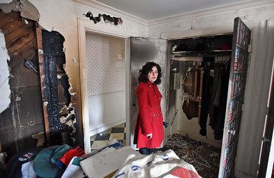 North Andover Selectwoman Rosemary Smedile stands in the destroyed den of her Greene Street home on December 13, 2018 - the walls torn open but firefighters battling a blaze which started in the home's basement during the September 13th Merrimack Valley gas disaster.